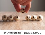 hand putting on a smiling... | Shutterstock . vector #1033852972