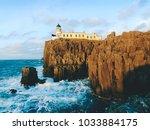 neist point lighthouse on rocky ... | Shutterstock . vector #1033884175