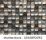 grunge light brown mosaic tiles.... | Shutterstock . vector #1033892092