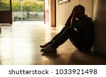 emotional moment  man sitting... | Shutterstock . vector #1033921498