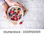 top view on oat flakes with... | Shutterstock . vector #1033926565