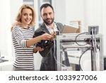 mutual help. joyful young... | Shutterstock . vector #1033927006