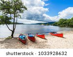 Red Kayaks On A Sandy Beach In...