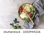 vegan quinoa porridge with kale ... | Shutterstock . vector #1033944226