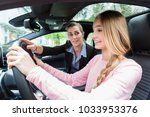 student on wheel of car in... | Shutterstock . vector #1033953376