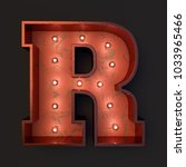 Small photo of Illuminated marquee light bulb letter R