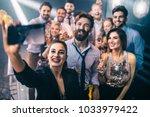 shot of a group of friends... | Shutterstock . vector #1033979422