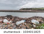 single use plastic bottles and... | Shutterstock . vector #1034011825