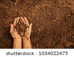 soil in a strong farmer's  man...