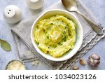 Small photo of Potato mash with olive oil,parmesan cheese and greens in a bowl over light slate,stone or concrete background.Top view.