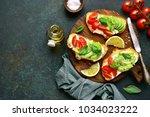 Toasts With Avocado  Tomato An...