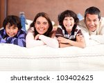 beautiful family lying in bed... | Shutterstock . vector #103402625