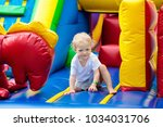 child jumping on colorful... | Shutterstock . vector #1034031706