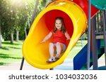 kids climbing and sliding on... | Shutterstock . vector #1034032036