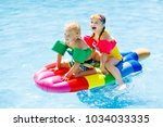 boy and girl on inflatable ice...   Shutterstock . vector #1034033335