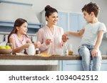 happy mother. attractive alert... | Shutterstock . vector #1034042512