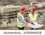 workers engineers discussing... | Shutterstock . vector #1034046028