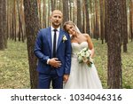portrait of bride and groom in... | Shutterstock . vector #1034046316