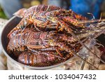 lobsters in fish market. stone... | Shutterstock . vector #1034047432