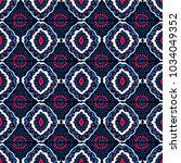 ikat geometric folklore... | Shutterstock .eps vector #1034049352