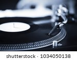 turntable with black record and ... | Shutterstock . vector #1034050138