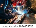 welder in mask welding metal...
