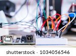 breadboard connected to arduino.... | Shutterstock . vector #1034056546