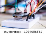 breadboard connected to arduino.... | Shutterstock . vector #1034056552