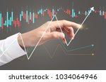 investment concept hand with...   Shutterstock . vector #1034064946