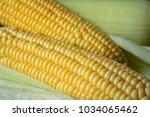 fresh corn on rustic white...   Shutterstock . vector #1034065462