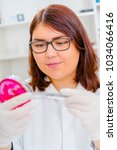 girl teen in the laboratory of... | Shutterstock . vector #1034066416