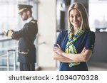 handsome male pilot and... | Shutterstock . vector #1034070328