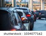 car in a big traffic jam. back... | Shutterstock . vector #1034077162