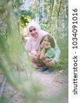 young arabian muslim girl with... | Shutterstock . vector #1034091016