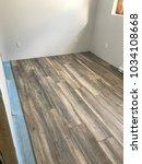 installing florring in house | Shutterstock . vector #1034108668