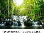 sam lan waterfall  amazing... | Shutterstock . vector #1034114356