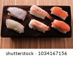 various different sushi... | Shutterstock . vector #1034167156