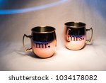 mr. and mrs. cups in light... | Shutterstock . vector #1034178082