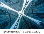 low angle view of skyscrapers... | Shutterstock . vector #1034186272