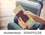 people holding passports  map... | Shutterstock . vector #1034191228