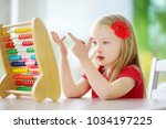 cute little girl playing with... | Shutterstock . vector #1034197225
