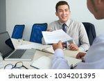 entrepreneur giving contract to ...   Shutterstock . vector #1034201395