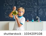 happy kid in goggles looking at ... | Shutterstock . vector #1034209108