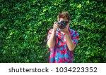 colorful shirt photographer... | Shutterstock . vector #1034223352