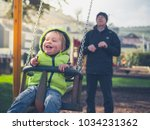 a grandfather is pushing his... | Shutterstock . vector #1034231362