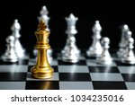 gold king in chess game face... | Shutterstock . vector #1034235016