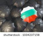 umbrella with flag of bulgaria... | Shutterstock . vector #1034237158