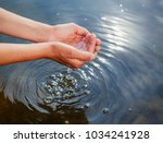 woman taking raw unfiltered... | Shutterstock . vector #1034241928