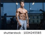 handsome young fit muscular... | Shutterstock . vector #1034245585