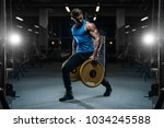 handsome young fit muscular... | Shutterstock . vector #1034245588